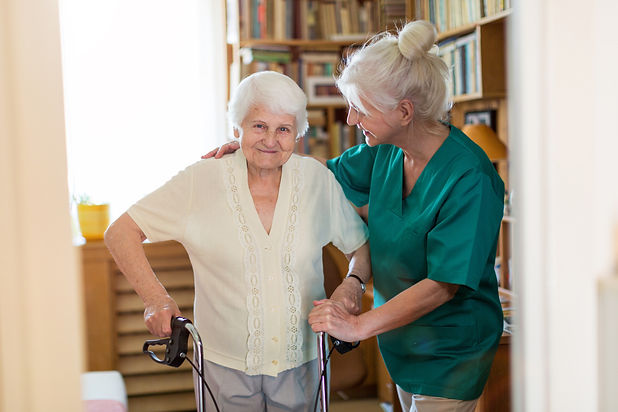 Older woman in her home being helped by nurse