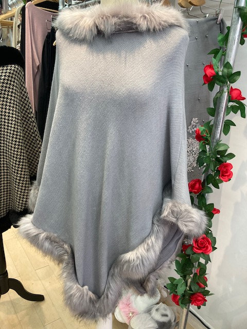 Poncho with Faux  Fur Trims Neck and Hem.