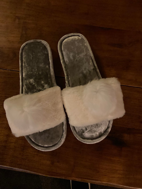 A Beautiful pair of fluffy Slippers with a Bobble