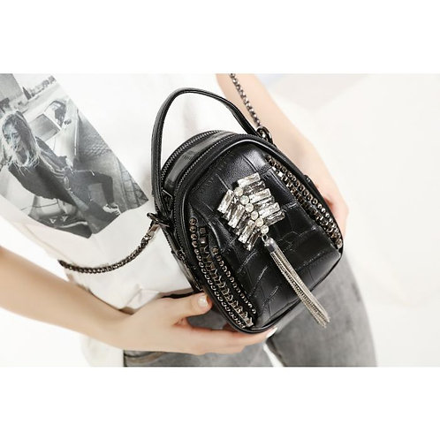 A Lovely leather hand bag with crystals front designs