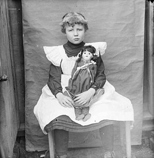 Portrait of a girl with a doll in Denver, Colo...