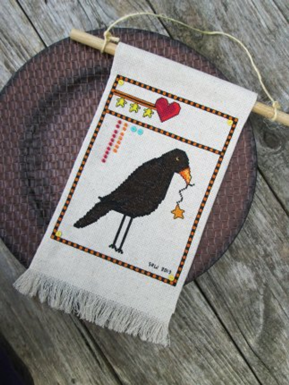 Protective Crow to watch over hearth and home.  Designed by SRW.