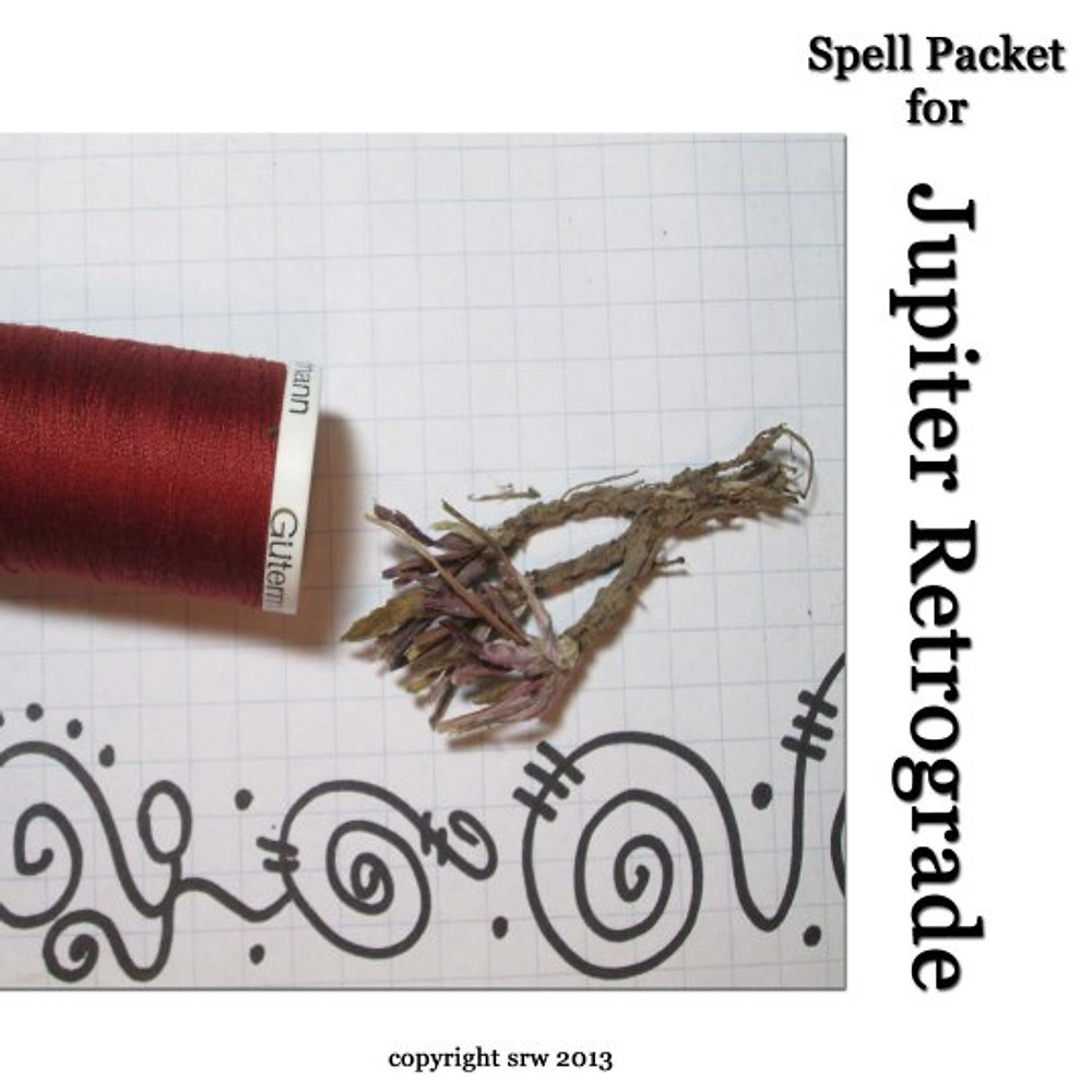 To hold your packet together, you will need red thread. This picture also shows a lucky dandelion root as it is split into three sections.