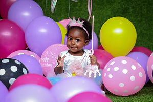 toddler-girl-sitting-on-ground-surrounde