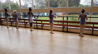 Our Grade 2 girls practising their barre work