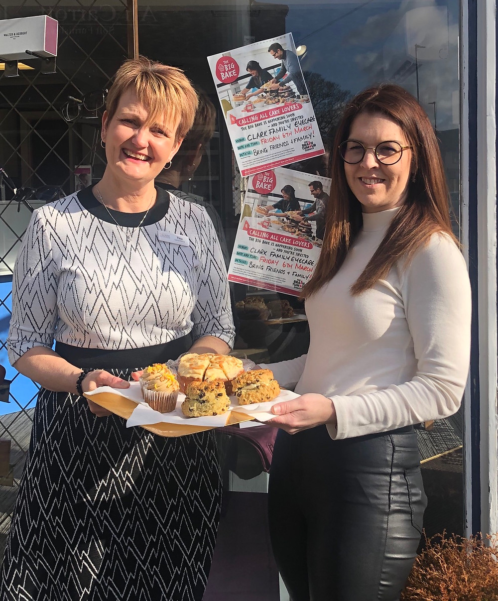 Tina and Annica holding cakes to advertise the Big Bake sale