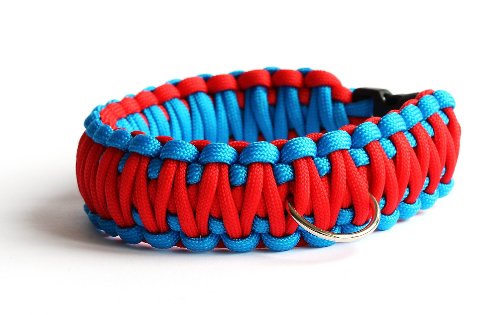 Photo of a light blue and red paracord bracelet