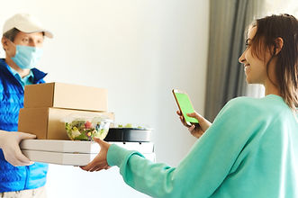 woman receiving packages from delivery m