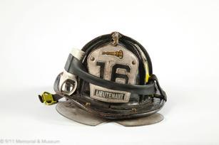 * Recovered fireman's helmet © 911 Memor