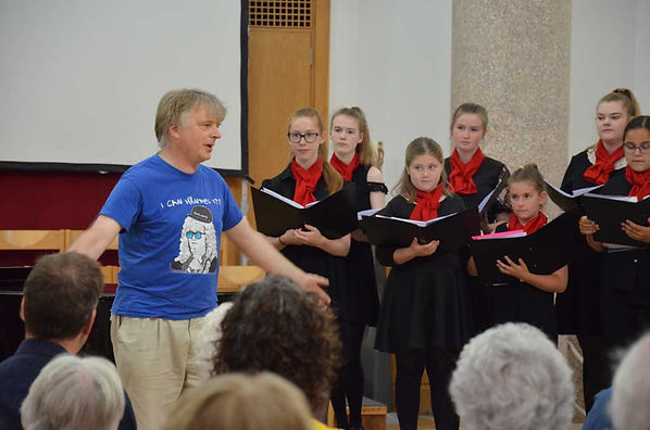 John Gibbons, the first conductor of MKYC, told us about founding the choir at our 21st birthday concert.