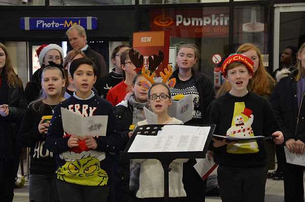 Having fun singing Christmas carols for commuters at MK Station, December 2019