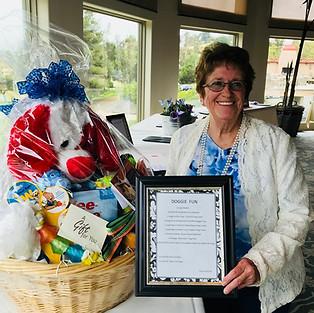 Bev York wins Doggie Basket Donation