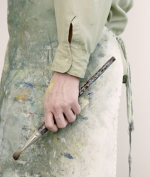 Artist Holding a Paintbrush_edited.jpg