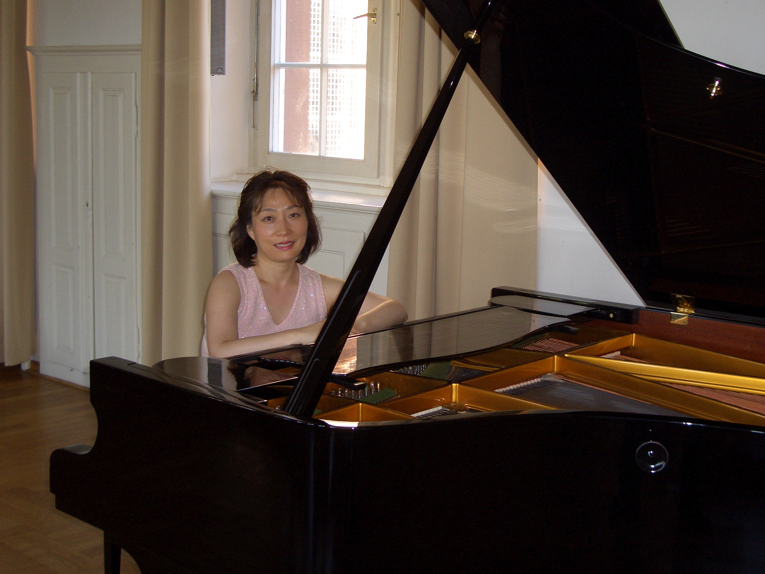 Dr. You Ju Lee at piano