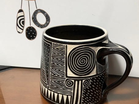 My love of black & white patterns in my three hanging ovals pendant and a coffee cup
