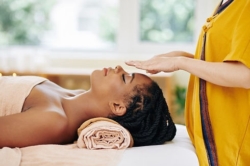 attractive-young-african-american-woman-getting-reiki-healing-therapy-spa-salon_274689-145