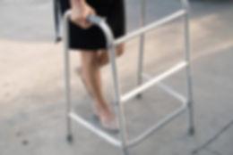 Woman usig a walking frame