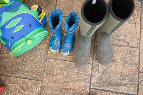 Wellies lined up waiting for forest school to begin