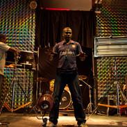 Kamau on stage