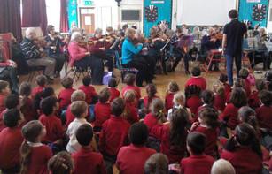Children listen to SARO