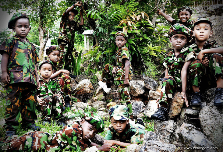 Mlitant - Children posing as sodiers on their career day. (c) Blaisegem Media