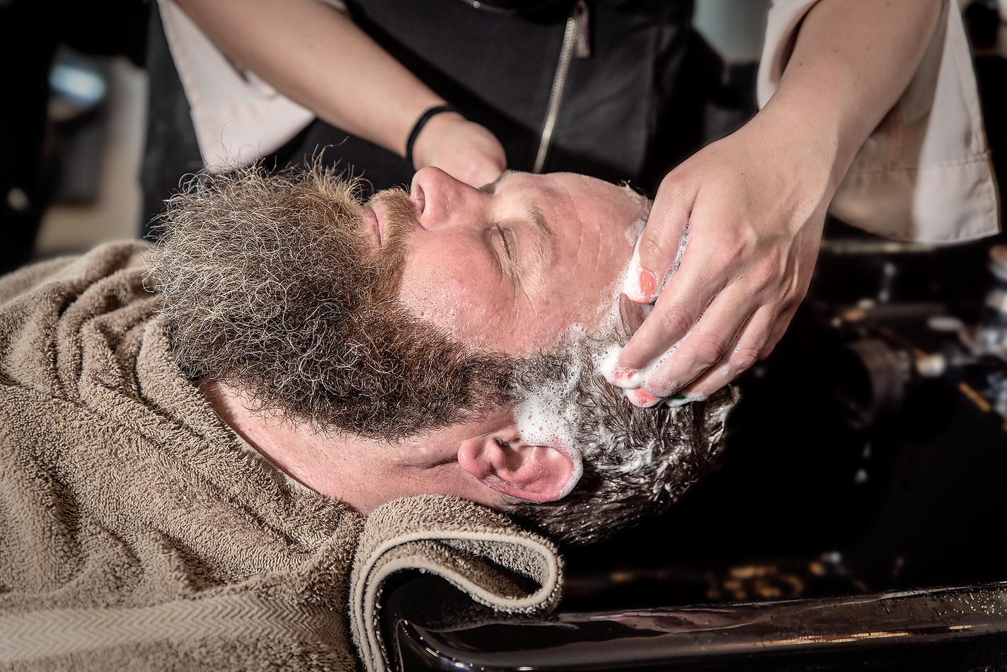 Certified Trichologist performing a scalp procedure for male hair loss
