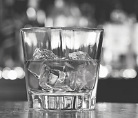 Glass of whiskey on the rocks for gentlemen at the bar