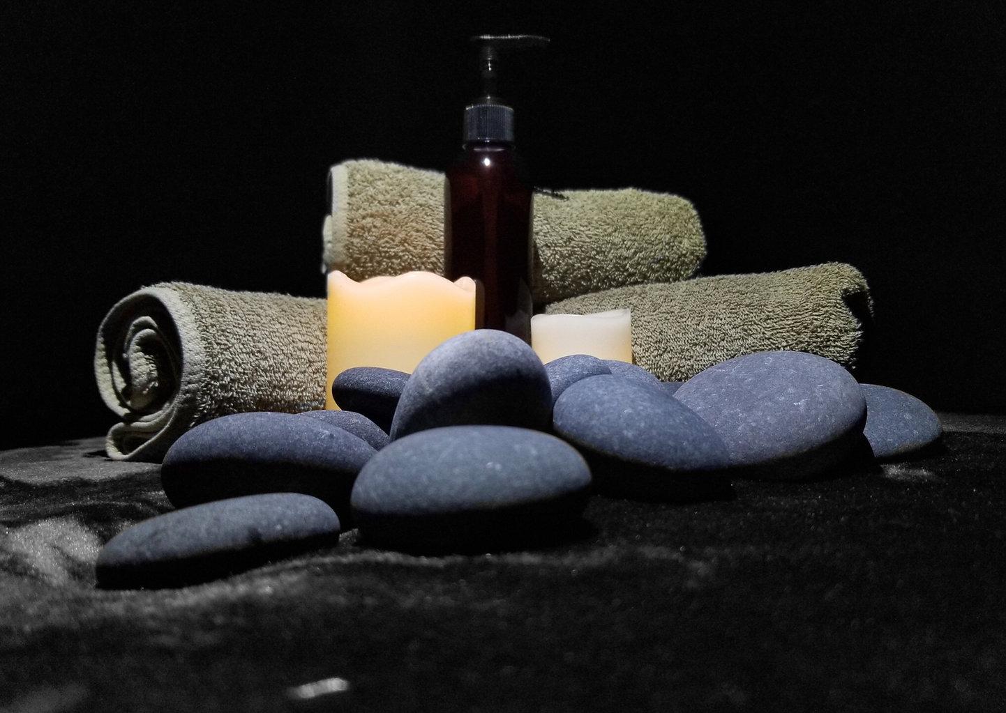 Low lit candles, fresh towels, massage oil for men's massage at Men's Den, Inc.