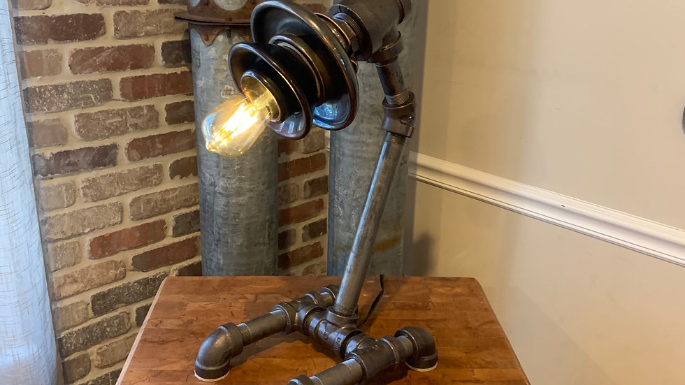Custom made industrial lamp made with porcelain insulator