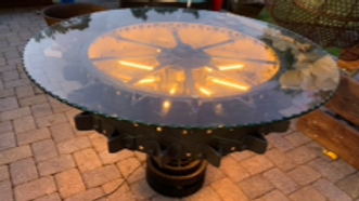 Custom made steampunk tractor wheel table