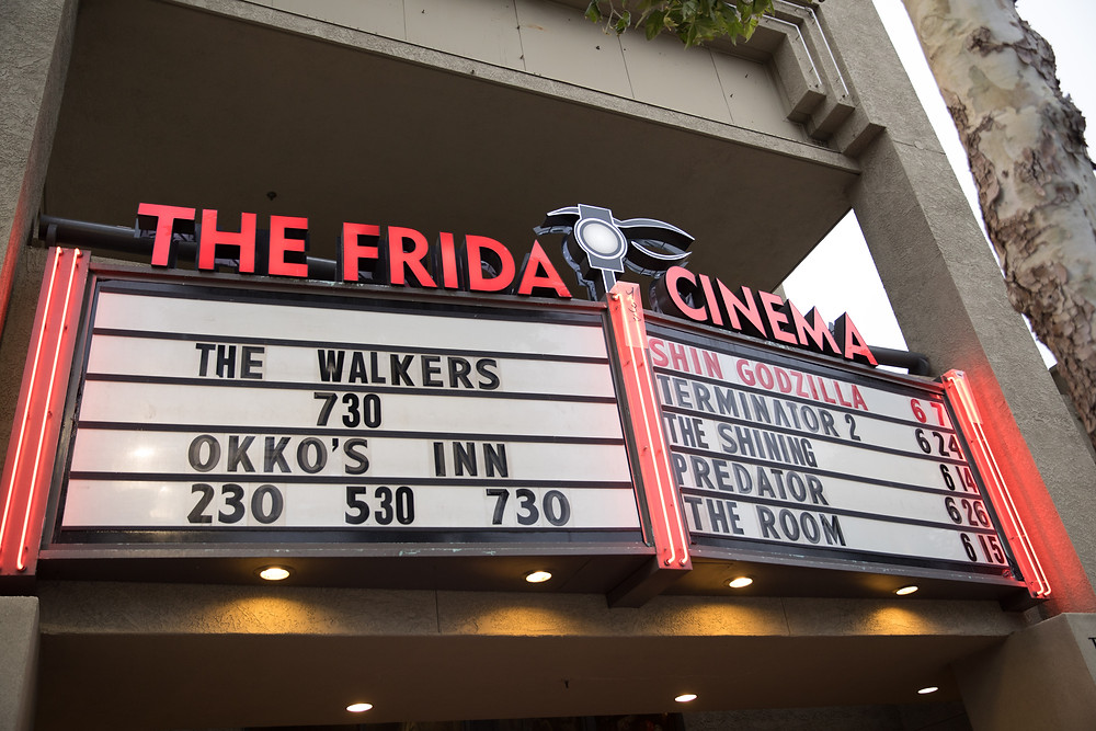 """box office title with cinema name in red at the top: THE FRIDA CINEMA. Shows include """"THE WALKERS 7:30"""""""