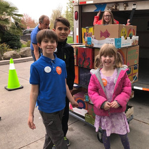 Easter toy drive delivery with kids.jpg