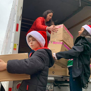 Zachary carrying boxes at Seattle Childr