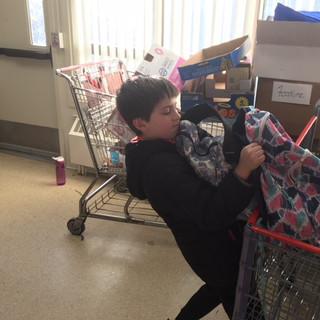 Zach packing up backpacks.JPG