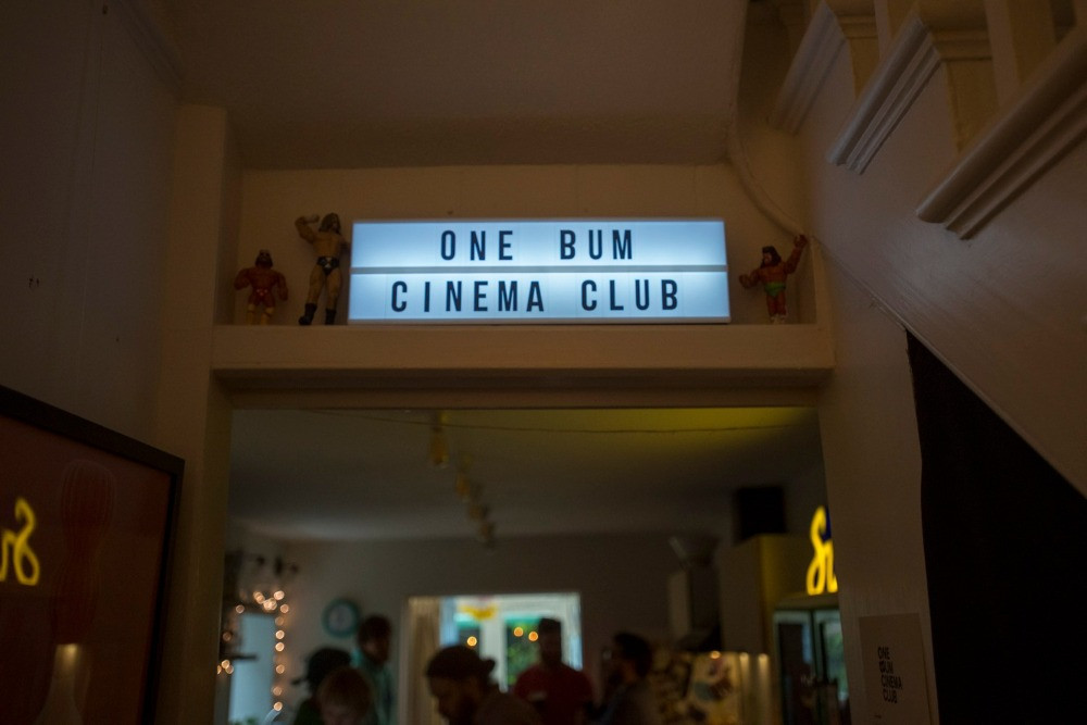 A lightbox sign with the text One Bum Cinema Club