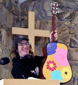 Caleb shows off his custom Guitar art by Hannah