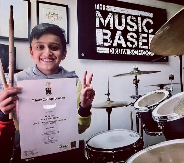 Kid drummer taking Trinity rock and pop drum exam in Tring