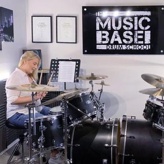 Beginner adult having drum lesson at music school in Wendover