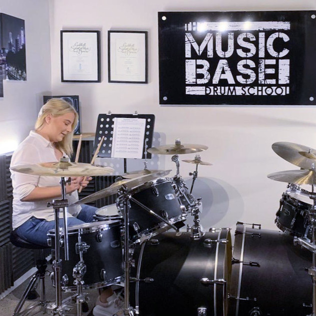 Beginner adult having drum lesson at music school in Wendover