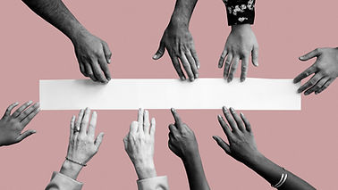 diverse-hands-touching-white-paper.jpg