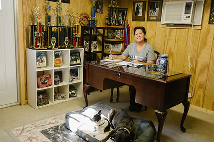 GH Monique at desk with dogs 2.jpg
