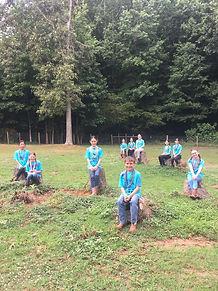 2021 YEC Campers sitting on stumps.jpg