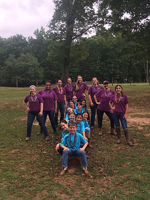 2021 YEC group campers & counselors on log.jpg