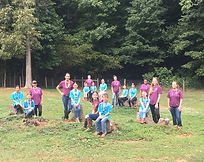 2021 YEC group campers & counselors sitting on stumps.jpg