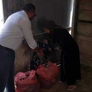 Distributing School bags  in Jub Al Deib