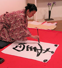 Michiko Imai performing calligraphy -pho