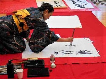 Michiko Imai performing calligraphy.jpg