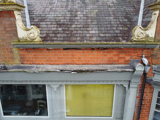 Commercial/retail building facade drone inspection in a city centre location