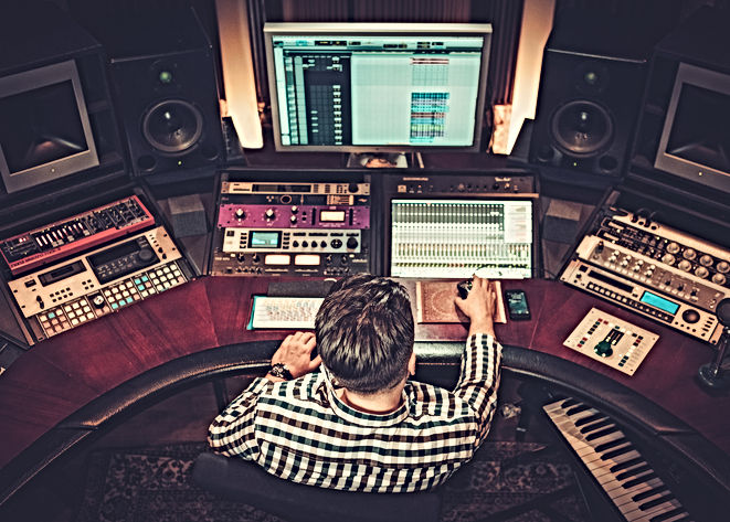 sound-engineer-working-at-mixing-panel-i