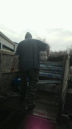 Volunteers load the trailer